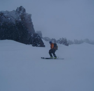 Retreating below Trinity Chutes Avalanche Gulch. Moderate avy conditions and visibility forced retre